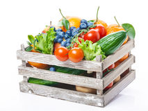 Fruits and vegetables, wooden box Royalty Free Stock Images
