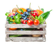 Fruits, vegetables in wooden box Stock Image