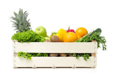Fruits and vegetables on wooden crane Stock Photo