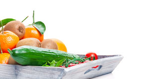 Fruits, vegetables, wooden tray royalty free stock images