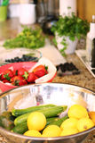 Fruits & veggies on counter Royalty Free Stock Images