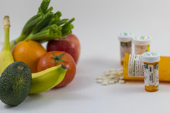 Fruits and veggies and pills Stock Photography