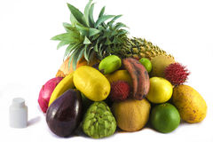 Fruits versus multivitamins Stock Photos