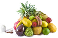 Fruits versus multivitamins Royalty Free Stock Photos