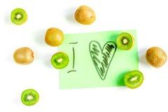 Fruits verts frais avec le kiwi sur la vue supérieure de fond blanc Images stock