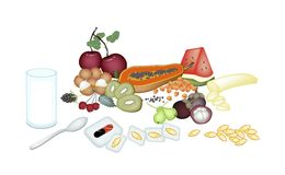 Fruits with Vitamin Capsules on White Background Stock Photo