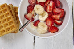Fruits in a waffle. Some strawberries and bananas in a cupt Stock Images