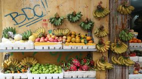 Fruit, bananas on pavement market, Ha noi,  Viet Nam. Fruits was arranged in different style in market Stock Images