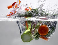 Fruits in water. Broccoli and carrot in water royalty free stock photos