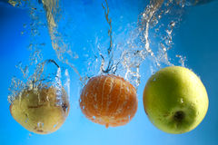 Fruits in water Royalty Free Stock Photos