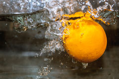 Fruits in water, aquashake, orange. An orange floating in water and bubbles Royalty Free Stock Photos