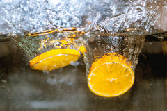 Fruits in water, aquashake, orange. An orange floating in water and bubbles Royalty Free Stock Photo