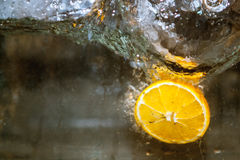 Fruits in water, aquashake, orange. An orange floating in water and bubbles Stock Images