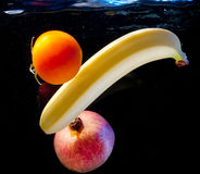 Fruits in water Stock Images