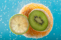 Fruits in water Royalty Free Stock Photo