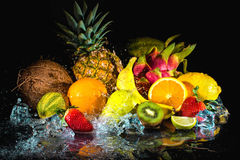 Fruits with water splash Stock Photos