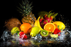 Fruits with water splash. Fruits on black background with water splash Stock Photography
