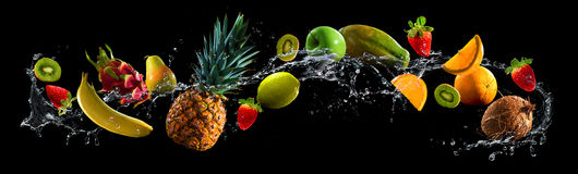 Fruits with water splash. Fruits on black background with water splash Stock Image