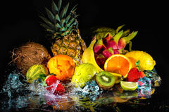 Fruits with water splash Stock Image