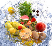 Fruits and water splash Royalty Free Stock Image