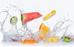 Fruits with water splashes Stock Images