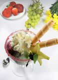 Fruits with whipped cream. Fruits with ice cream, whipped cream and sugar decoration Royalty Free Stock Photo