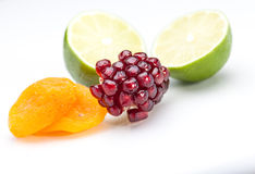 Fruits on white. Lime, Pomegranate and apricot on white seamless stock image