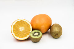 Fruits on the white background. One whole and sliced orange and kiwi fruit  on the white background Royalty Free Stock Photos