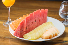 Fruits on white plate Royalty Free Stock Image