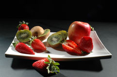 Fruits on white plate Stock Photos