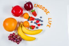 Different Fruit arrangement on white table with Choose Life message stock photography