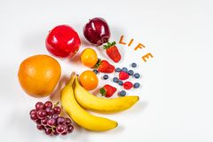 Variety of fresh Fruits with Word Life in it on white background. stock images