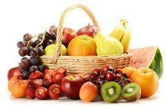 Fruits and wicker basket Stock Image
