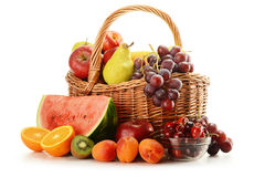 Fruits and wicker basket isolated on white Stock Photography