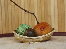 Fruits on the wicker baskets Stock Images