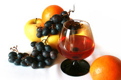 Fruits and wine. A still-life with fruits and a wine glass Royalty Free Stock Photos