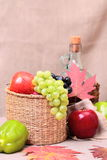 Fruits, wine and autumn leaves Royalty Free Stock Photo