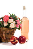 Fruits, wine and flowers Stock Image