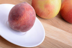 Fruits on wodden table, peach, apple, health food. Fruits on wodden table, peach, apple, food concept Stock Image