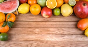 Fruits on wood texture background with space for text. Stock Images