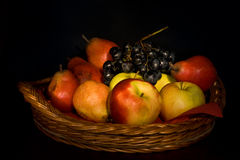 Fruits in wooden basket Stock Photos