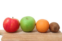 Fruits on a wooden board Royalty Free Stock Photos