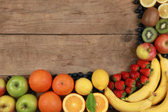 Fruits on a wooden board Royalty Free Stock Photo