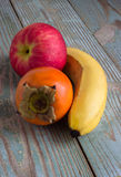 Fruits on a wooden board Stock Photos