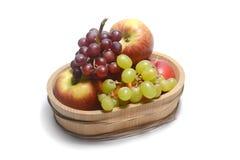 Fruits in wooden bucket Stock Photos