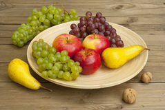 Fruits on wooden dish Stock Photos
