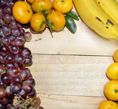 Fruits on the wooden floor. Grape,Orange and banana on the wooden floor backgrounds Royalty Free Stock Image