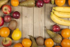 Fruits on wooden plank Stock Photo