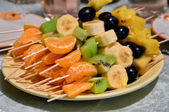 Fruits on a wooden skewer. Fruits on wooden skewers. Festive dish royalty free stock photography