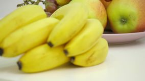 Fruits on a wooden table stock video